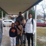 Titan Basketball greeting kids at Walnut Park and Striplin Elementary Schools