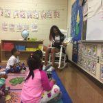 Titan Cheerleaders serve at Thompson Elementary