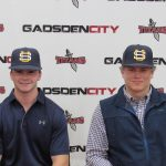 Titan's Brewer and Gray sign collegiate scholarships