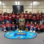 The Titan Cheerleaders participate in Read Across America