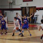 Varsity Boys Basketball Defeats Mason