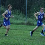 Knight Runners Dominate Home Opener