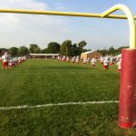 Football competes in scrimmage