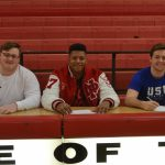Four football players sign to play in college