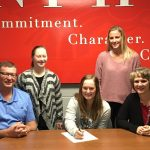 Black signs to play golf at Fort Wayne