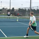 Boys tennis sweeps Trojans