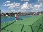 Tennis wins conference opener