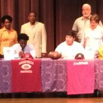 Andrew Collins and River Vaughn Sign Scholarships