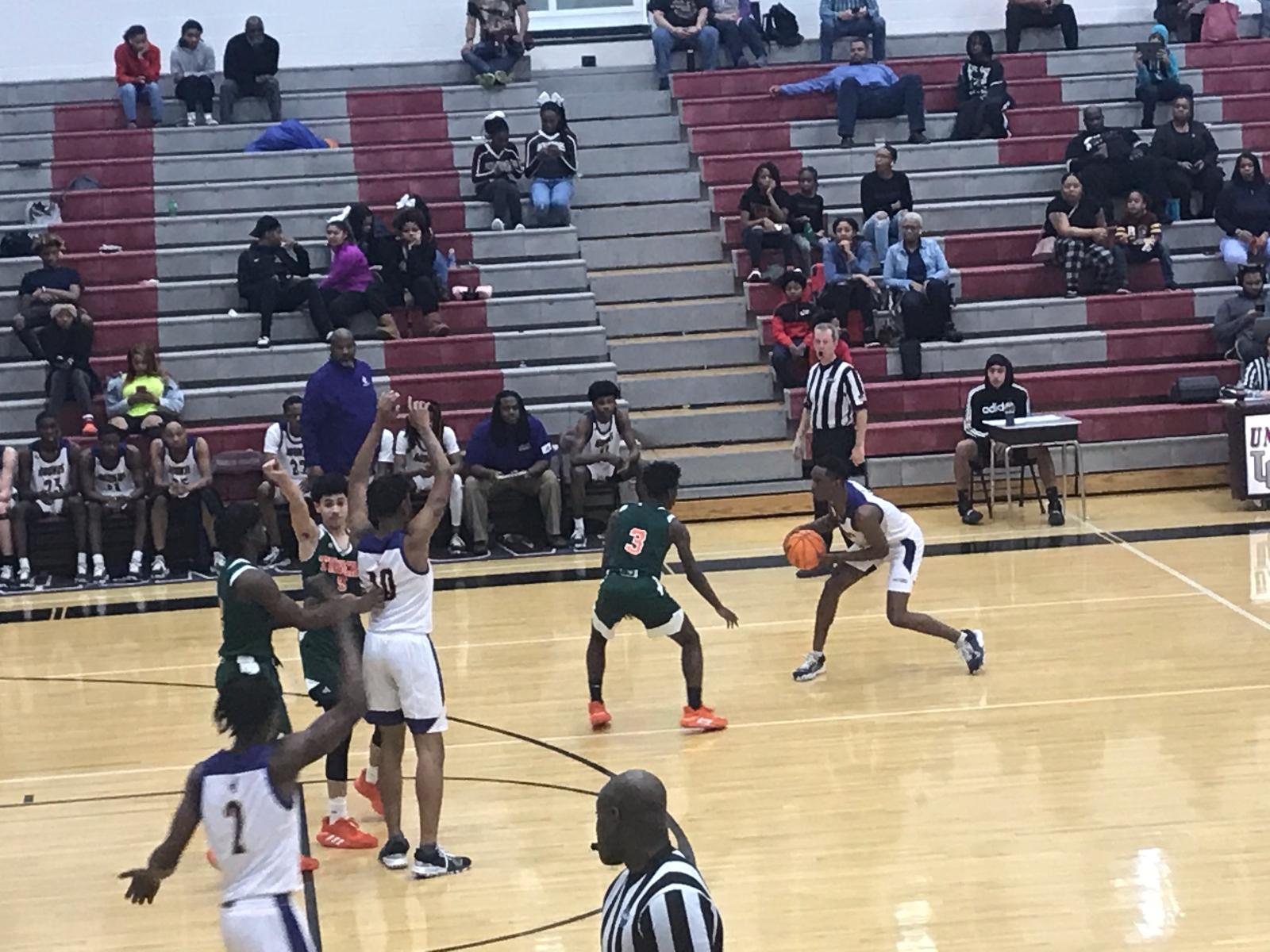 Basketball Advances in Region Tourney