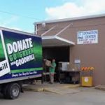 FOOTBALL TEAM PARTICIPATES IN GOODWILL DRIVE