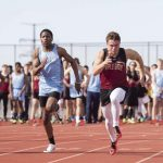 Track: Athletes compete at Hamline Elite, rainy Crimson Invite