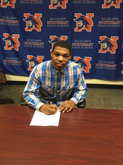 Wallace Signs with Erskine