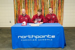 Jack Braman signs to play baseball at Aquinas