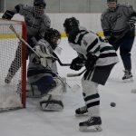 Farmington High School Boys Varsity Hockey falls to Novi High School 4-3