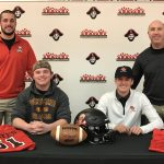 Football Players Sign on National Signing Day