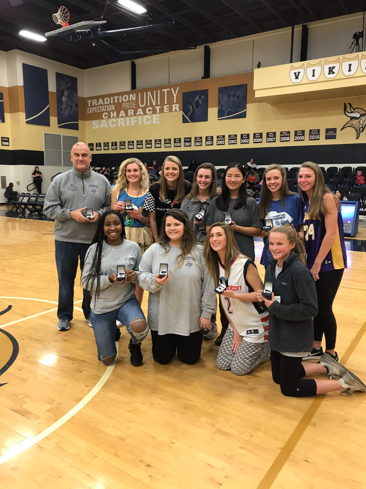 Girls tennis presented state championship rings