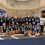 Cheerleaders supporting D7 Opening Convocation