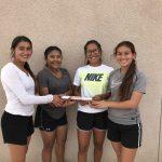 Girls' 4×100 relay team breaks school record.