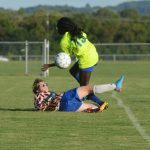 Goalie Fiona King with the block
