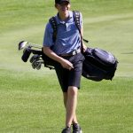 Simley Edged by Hill-Murray While Handling Tartan