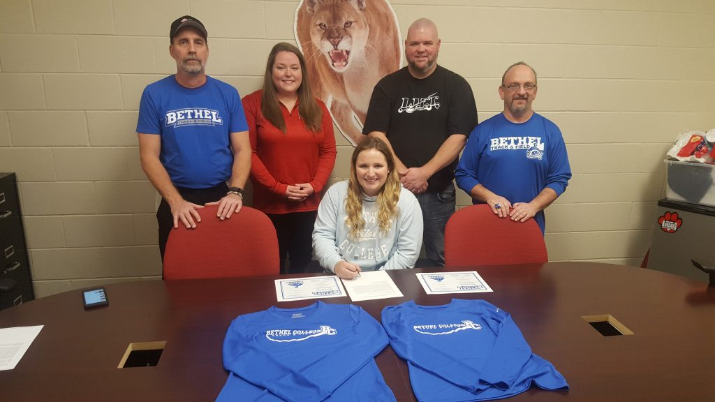 picture of Kirsten and here coaches.