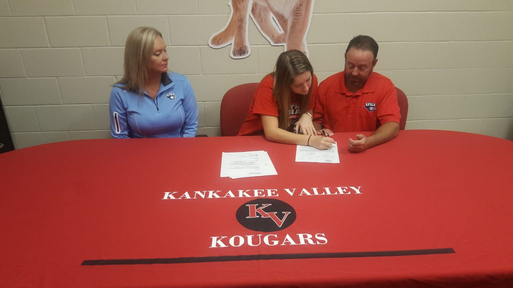 Halle and Dad signing