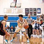 Boys Varsity Basketball beats Redmond 64 – 50