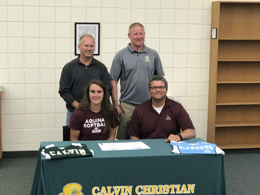 Softball Alert:  Kaleigh Whitcomb signs with Aquinas College