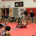 Grapplers pin down victory against rival