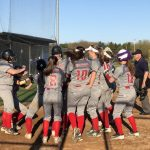 Lady Red Devils gather at the plate to celebrate Maci's Grand Slam