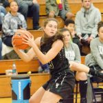 The West Salem Titans earned a 63-55 victory over the St. Mary's Academy Blues