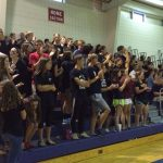 Students Help Varsity Volleyball Black Out Woodlawn