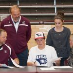 Brown Signs with USI!