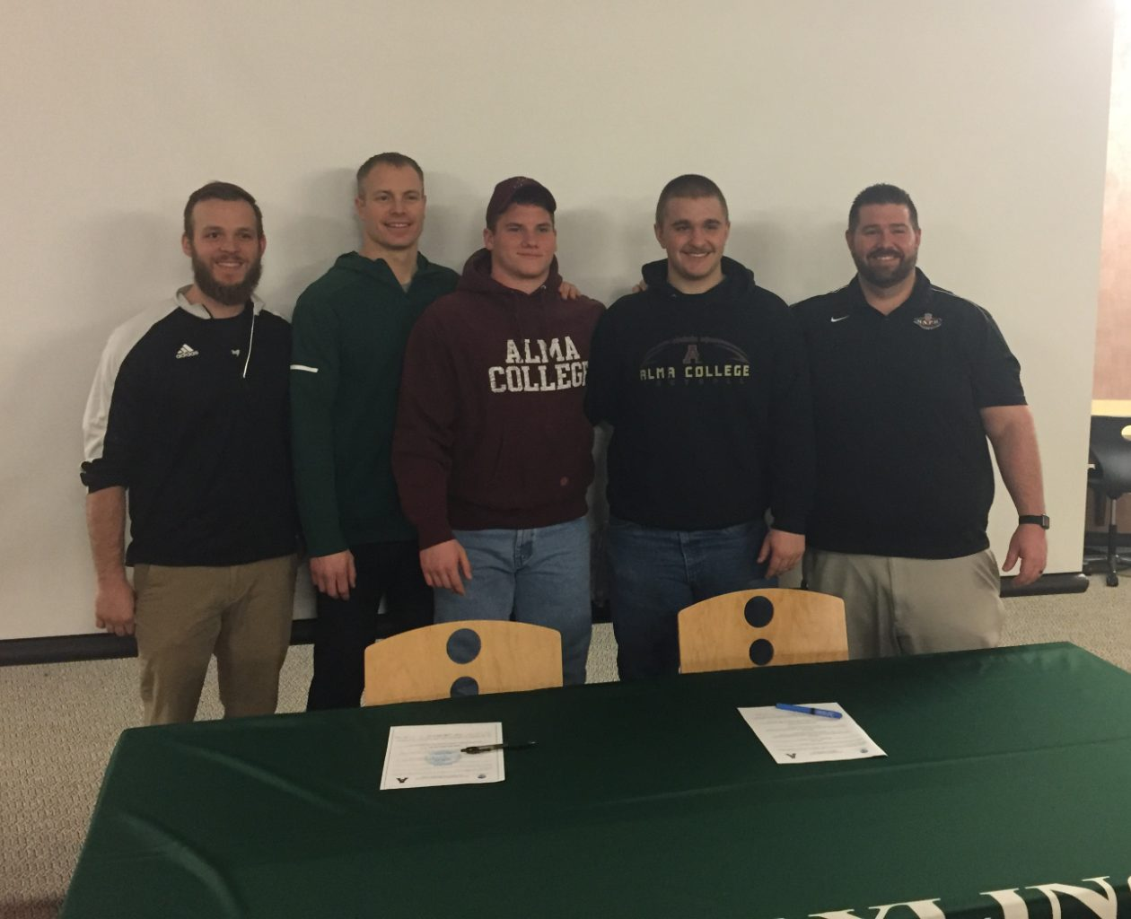 Eli Jackson and Nick Bluemlein Sign to Play Football at Alma College