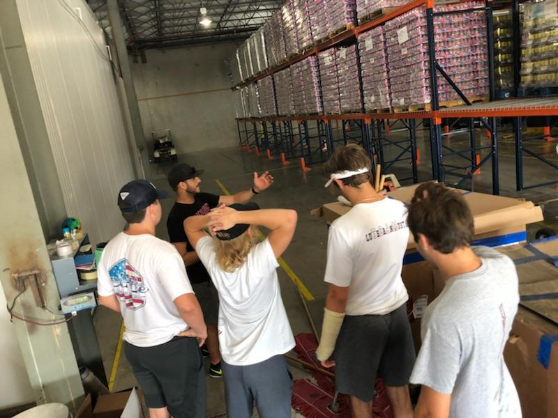 LHS, Other Football Teams Come Together to Serve Community