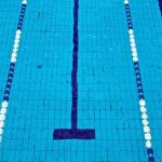 Girls Varsity Swimming falls to Mona Shores 114 – 71