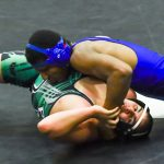 Spartans open league schedule with win