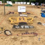 Marion Giant Cheerleaders create GFND sand sculpture