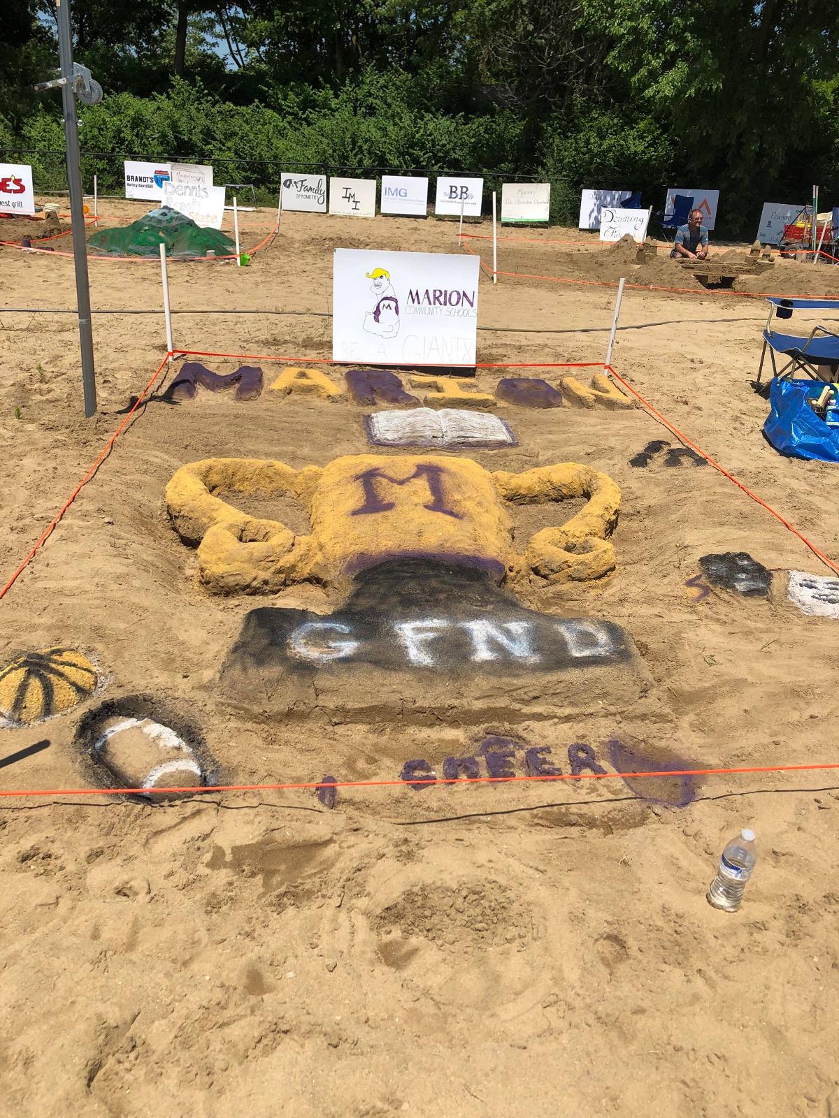 Marion Giant Cheerleaders create GFND sand sculpture