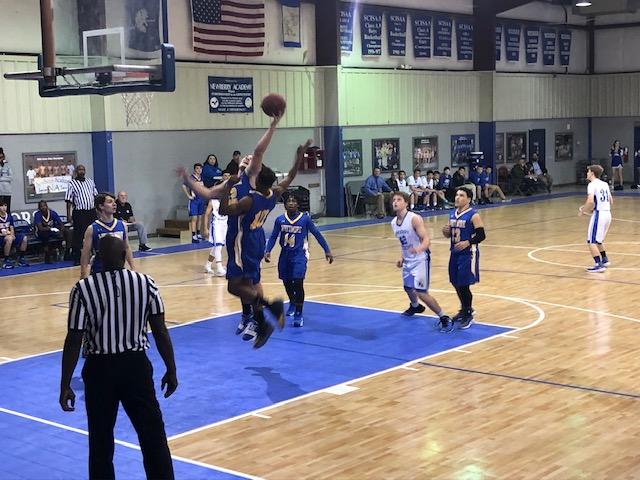 Boys Varsity Basketball beats Newberry Academy 39 – 34