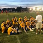 Varsity Football attends FCA Camp