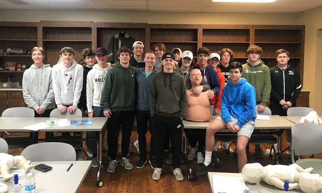 BOYS LAX TEAM PARTICIPATES IN CPR CLASS IN HONOR OF FORMER COACH