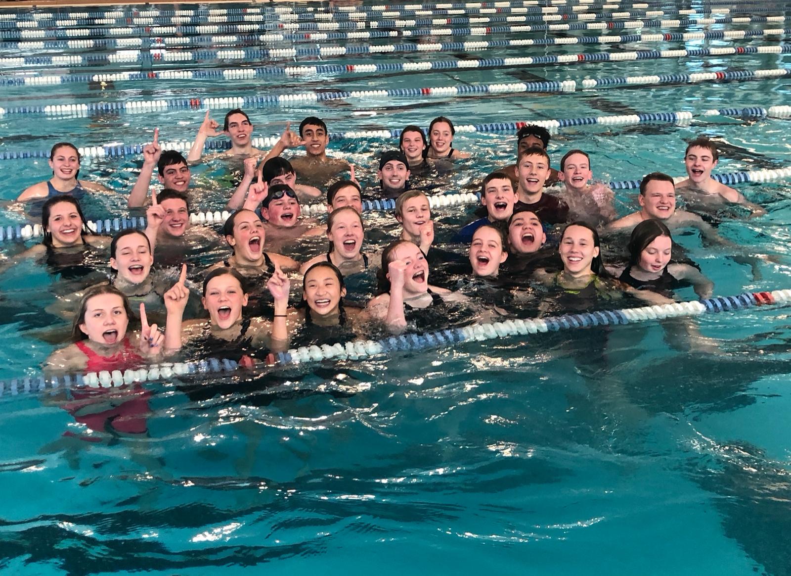 Timpview Swim Teams take Region 7 Title.