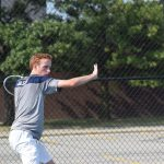 Tennis player sets up for forehand