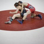 15 area wrestlers advance to quarterfinals