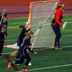 Powers Catholic High School Girls Varsity Lacrosse falls to Midland Dow H.S. 8-6