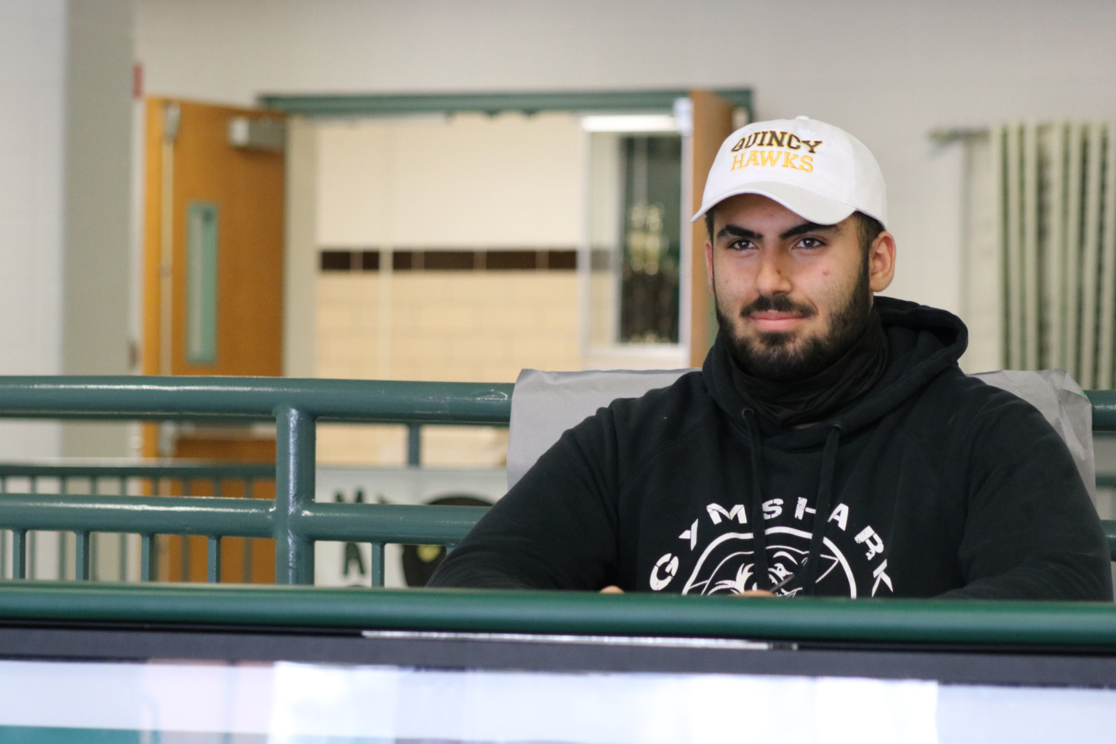Mustafa signs with Quincy to play football