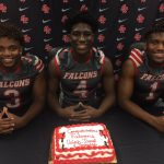 ER football has three athletes make college decisions