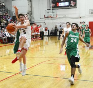A member of the boys basketball team goes up for a layup.
