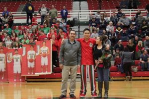 Families pose on senior night for basketball/cheerleading 2018.